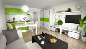 Moderní byt s vybavenou kuchyní, stolem a televizí na stěně